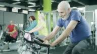 Senior man exercising on stationary bike video