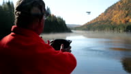 Senior Man Flying a Drone, Autumn Landscape, Quebec, Canada video