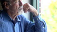 Senior Man Gazes out of Window video
