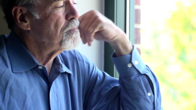 Senior Man Gazes out of Window video