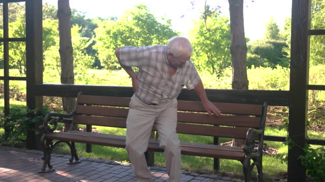 Senior man has backache. video
