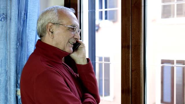 senior man having a conversation using mobile phone video