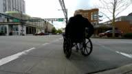 Senior Man in Wheelchair Crossing Street video
