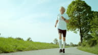 SLO MO TS Senior man jogging in nature video