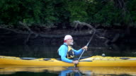 Senior Man Kayaking in Nature - LS video