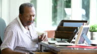 Senior Man Looking At Picture In Frame And Photo Album video