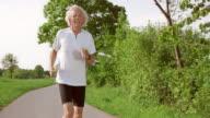 SLO MO TS Senior man on his daily run video