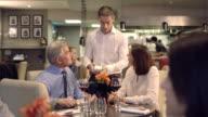 MS Senior man paying bill through credit card reader video