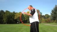 Senior man playing with hula hoop video