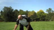 Senior man playing with soccer ball video