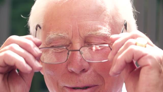 Senior Man Puts on Glasses video