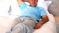 Senior man relaxing on his bed video