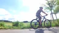 Senior man riding his mountain bike video