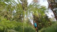 SLO MO CS Senior man running on forest trail video