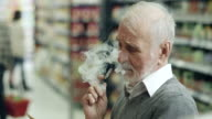 Senior man shopping and vaping video