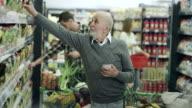 Senior man shopping video