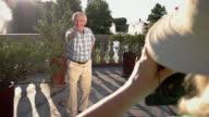 Senior man shows thumb up. video