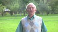 Senior man talking to camera. video