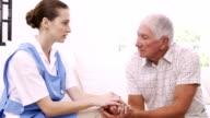 Senior man talking to nurse video