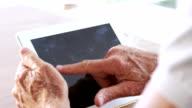 Senior man using tablet video