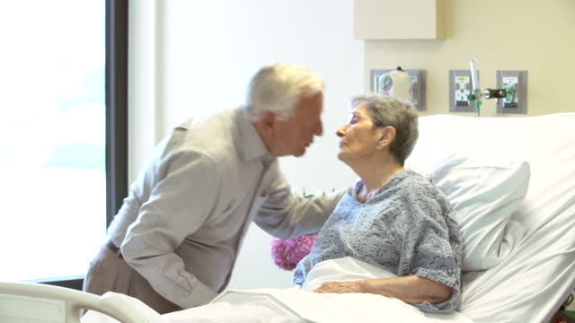 Senior Man Visiting Wife In Hospital Room video