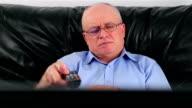 Senior man watching TV video