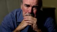 Senior Man Weeps in Despair video