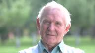 Senior man winking. video