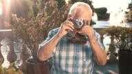 Senior man with camera. video