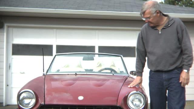 Senior man with classic car video