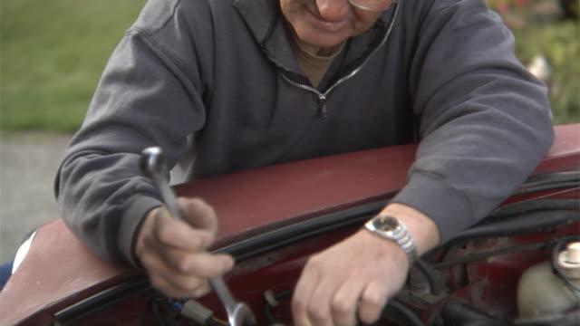 Senior man working on car engine video