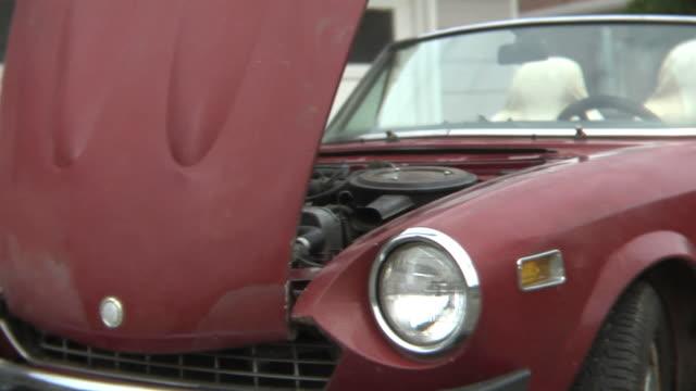 Senior man working on classic car video