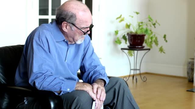 Senior Man Worries over Bills and Documents b video