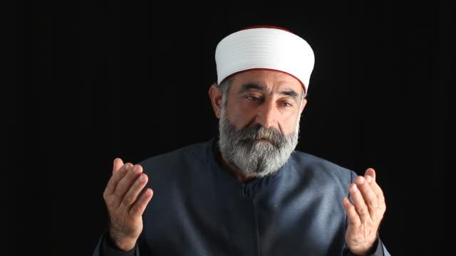 Senior Muslim Imam In Religious Costume Praying video