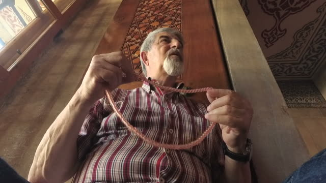 Senior muslim man with rosary praying video