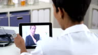 Senior patient video chatting with doctor on ipad video