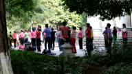 Senior people exercising outdoors in China video