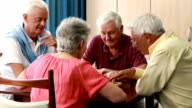 Senior people playing chess video