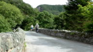 Senior people walking on old bridge video