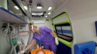 Senior person receiving medication via intravenous therapy in ambulance video