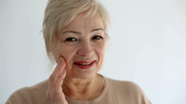 Senior portrait, happy old woman smiling. Slow motion video
