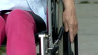 Senior pushing wheel chair video