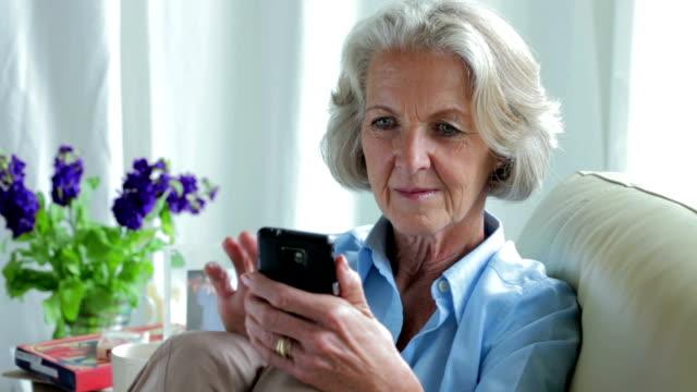 Senior texting sofa    CM LI RO video