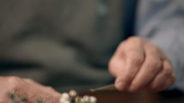 Senior watchmaker assembling watch video