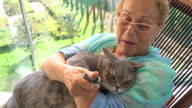 senior woman and her cat video