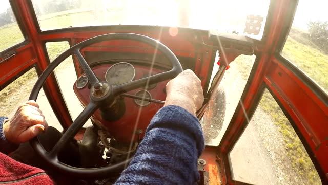 SLO MO Senior Woman Driving A Tractor video