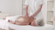 HD DOLLY: Senior Woman Enjoying Professional Massage video