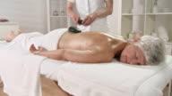 HD CRANE: Senior Woman Getting LaStone Therapy video