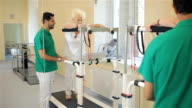Senior woman goes on rehabilition treadmill video