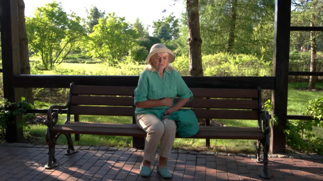 Senior woman has stomach ache. video